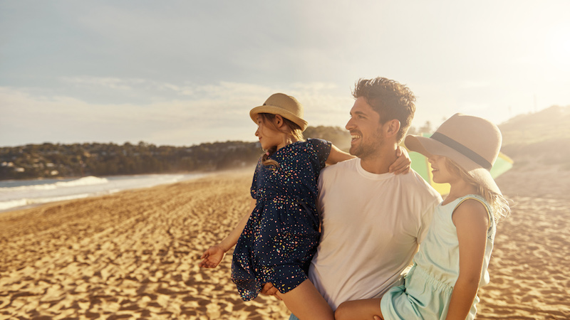 father-with-kids-near-ocean